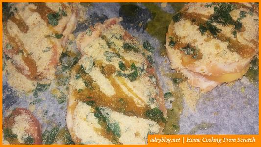 cheesy sliced pork loin in garlic crumb crust before baking